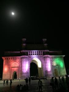 The Gateway To India monument at night.